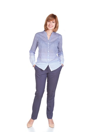 Full length portrait of beautiful mature woman standing isolated over white background photo