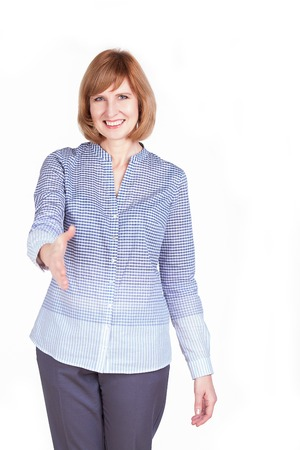 Portrait attractive mature woman with welcome gesture. Isolated on white background photo