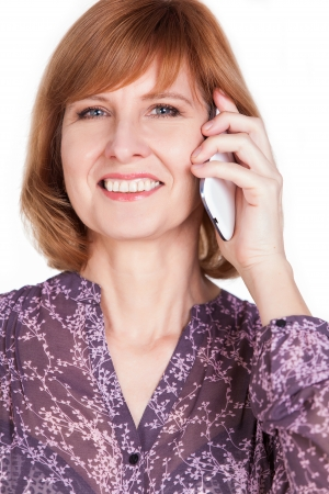 Happy mature lady talking on mobile phone. Isolated on white background. photo