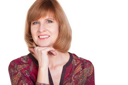 Portrait of a pretty mature woman smiling against white background. photo