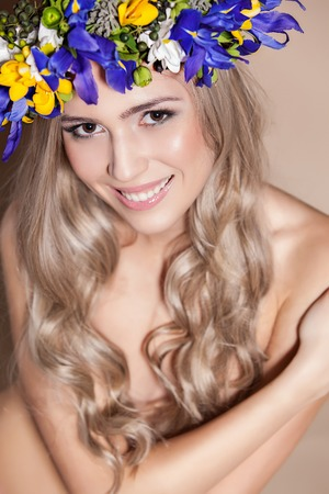 Young woman with a flower arrangement in her hair photo
