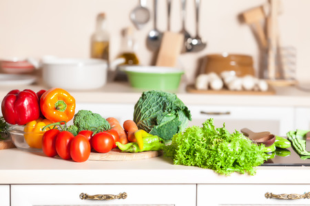 healthy foods are on the table in home kitchen