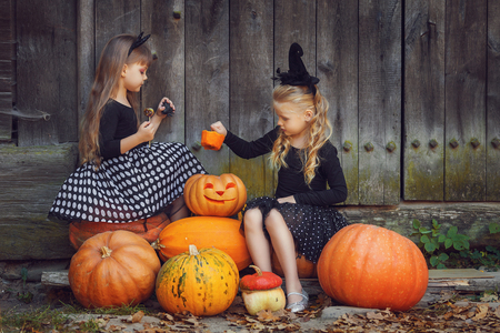 witch: Happy group witch children during Halloween party Stock Photo
