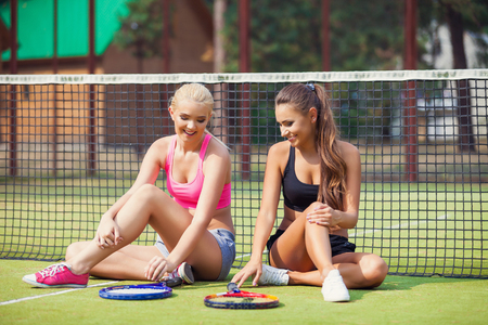 tennis player: Beautiful female tennis players playing doubles at tennis at the tennis court