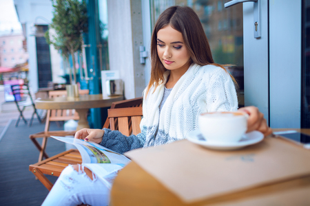 cafe: Young woman in a cafe