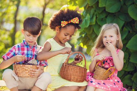 peers: A happy group of Multi-ethnic children sitting happily