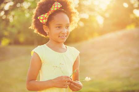 hispanic girl: Outdoor portrait of pretty mixed race African-American girl smiling outdoor