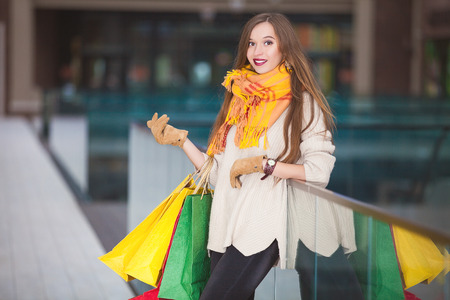 excitation: Cheerful shopping Woman holding bags Stock Photo