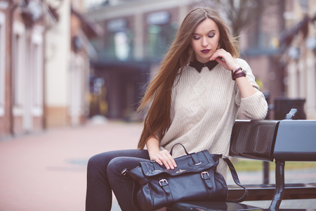 Fashion Young Woman with a leather bag. Fashion photo Stock Photo