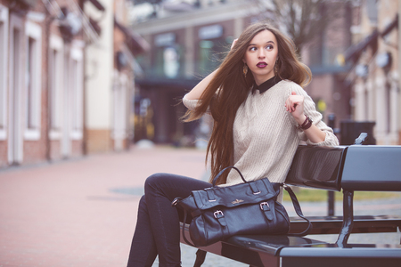body bag: Fashion Young Woman with a leather bag. Fashion photo Stock Photo
