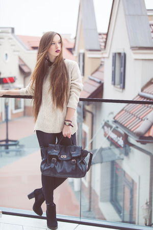 Fashion Young Woman with a leather bag. Fashion photo Imagens