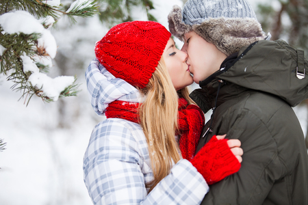 winter vacation: Winter beautiful couple. Family Outdoors