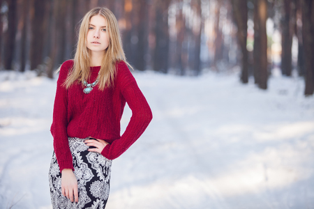 frost winter: Young beautiful model posing in winter forest. stylish fashion portrait