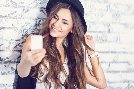 Hipster girl using a phone Stock Photo