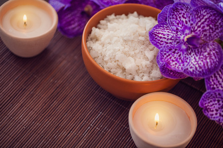 aromatic: Spa Still life with aromatic candle and orchid flower Stock Photo