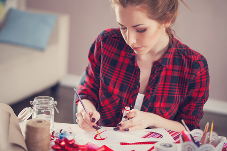 gouache: Woman creating gift at home with paper and gouache