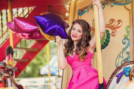 merry go round: Beautiful young girl on a merry go round