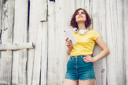 going crazy: Funny Hipster Girl over white old wooden wall, hipster outfit Going Crazy at tropical island.Trendy Casual Fashion Outfit in summer, spring.Toned Photo, Copy Space. Stock Photo