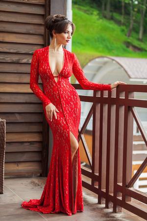 enchantress: Elegant young woman in evening dress posing in luxury interior. Fashion shot
