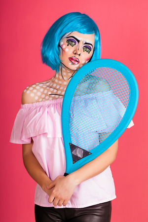 Photo of young woman with professional comic pop art make up and accessories. Creative beauty style. Imagens