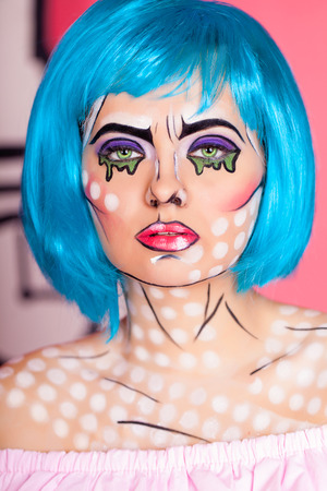 woman accessories: Photo of young woman with professional comic pop art make up and accessories. Creative beauty style. Stock Photo