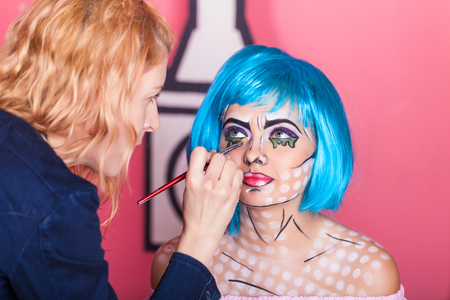 makeup artist: Professional make-up artist makes comic pop art make up. Creative beauty style