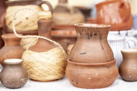 Different pottery products: bowls, vases, jars on the market.