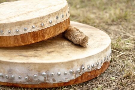 Shamanic tambourine. Shamanic drum. shaman tambourine lies on the grass