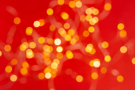 Christmas holiday background with festive bokeh on red background. Ready-to-install products. blur and bokeh. holiday blur lights. copy space. space for text