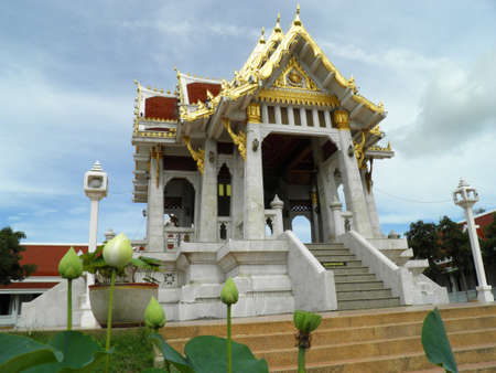 Thai temple and White lotus flower photo
