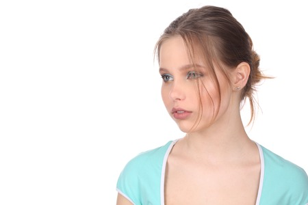 Girl wearing blue top looking away Stock Photo