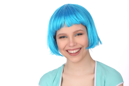 Smiling girl in blue wig Stock Photo