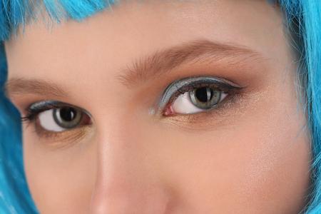 cheekbones: Girls eyes and blue hair Stock Photo