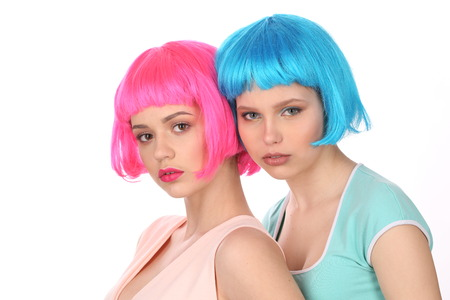 wigs: Ladies in colorful wigs and T-shirts posing