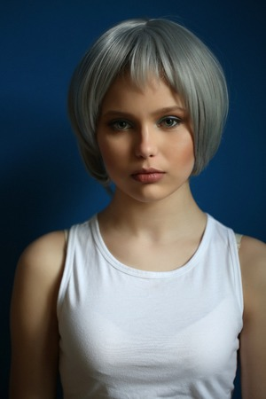 white singlet: Girl in silver wig and white singlet posing Stock Photo
