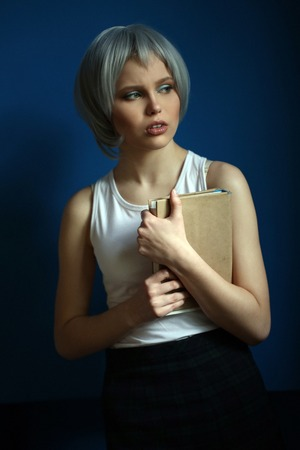 silver hair: Girl with silver hair and book in her hands