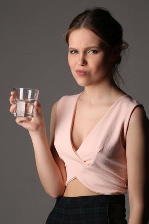 collarbone: Dissatisfied lady with glass of water