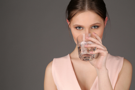 collarbone: Lady with makeup drinking water