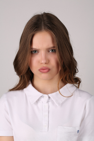 big shirt: Serious lady in white T-shirt, high fashion look, healthy lifestyle, beautiful girl, smiling girl, isolated, perfect make-up, big lips, model in studio, close up, white background