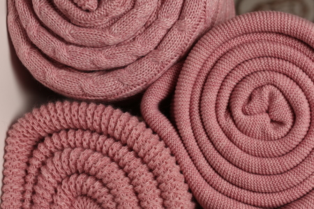 Twisted pink blankets, lazy winter weekend, pink knites, spa and wellness, home and comfort , close up Stock Photo