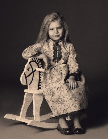rocker girl: Old photo of kid sitting on rocking horse, horses for toddlers ,antique photos, black and white, rocking toys, kids riding horses, wooden horse toy kids and gifts, blonde girl, baby in studio,