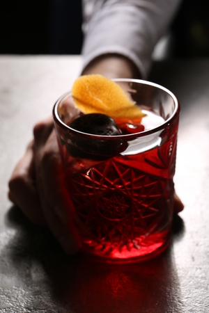 sweet vermouth: Negroni in the hand. Close up