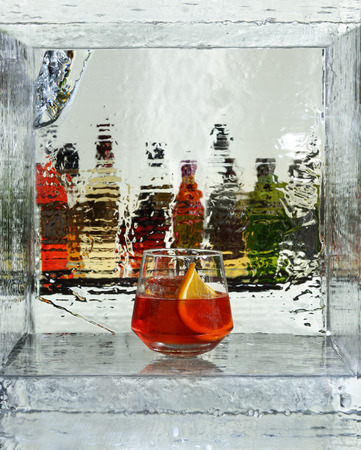 Red cocktail with a slice of orange. Close up Stock Photo