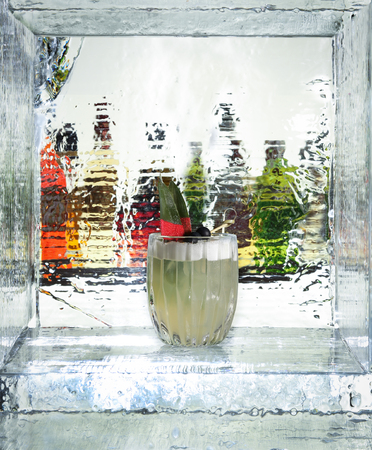 abstract liquor: Tasty cocktail in the ice cube. Close up Stock Photo