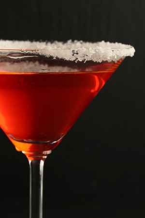 Cocktail with sea salt on black background. Close up