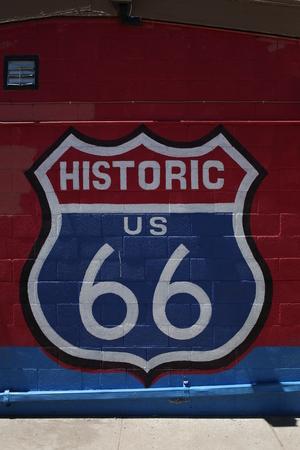 Historic us 66 sign on brick background. Close up
