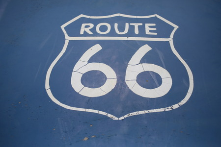 Route 66 sign on blue background. Close up