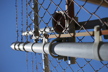 forbid: High fence with barbwire. Close up