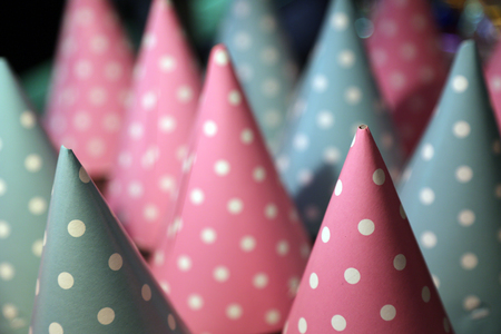 Pink and blue party hats. Close up