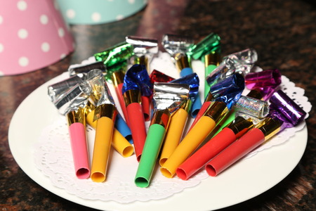 Party blowers on plate. Close up Stock Photo